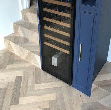 Cladding Stairs in Engineered Herringbone Parquet Flooring   Case Study