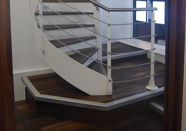 Cladding Stairs with Fumed Oak & Metal Inserts