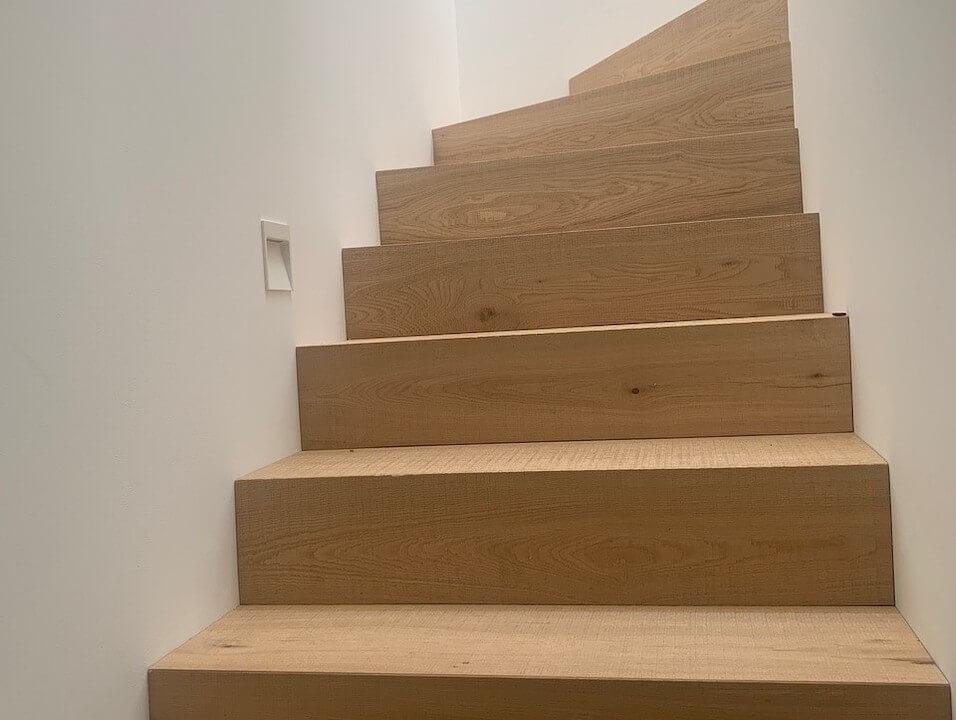 Cladding Winding Stair Case with Brushed Band Sawn Oak