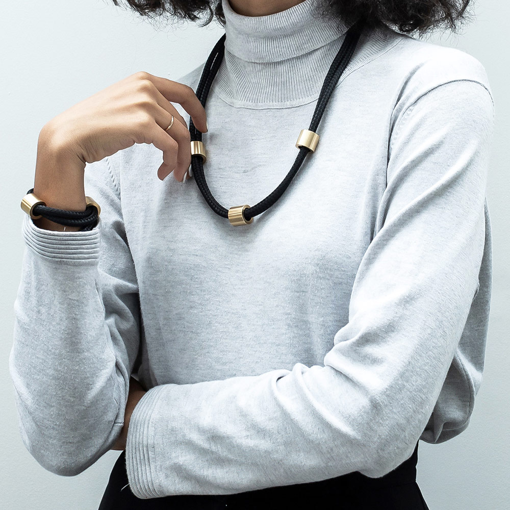 The Arden necklace and bracelet can take you seamlessly from day into night with its versatile, tactile and refined design.