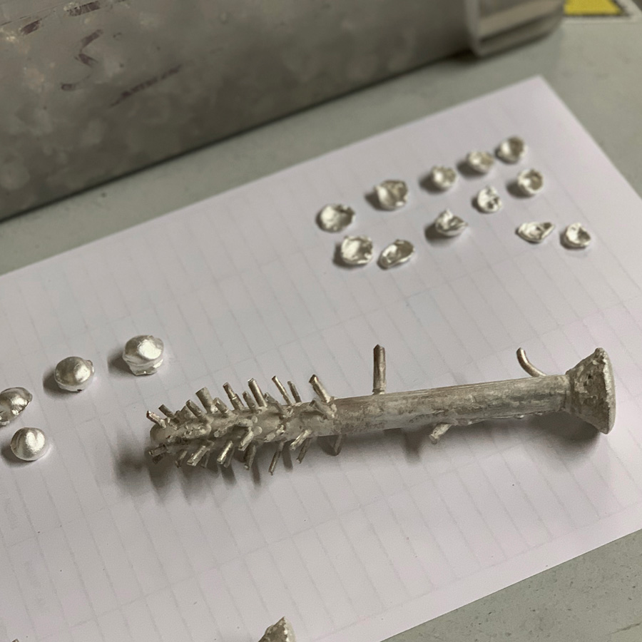 The collection derives from the age-old process of Lost Wax Casting. Residual silver from the traditional casting process is collected, melted down and dropped into water to create beads to recycle. By experimenting with the water drop process, adapting the height and size of the molten metal droplets that fall into the water, we have influenced the forms created at this stage of the process and use the silver in a zero waste single cycle.