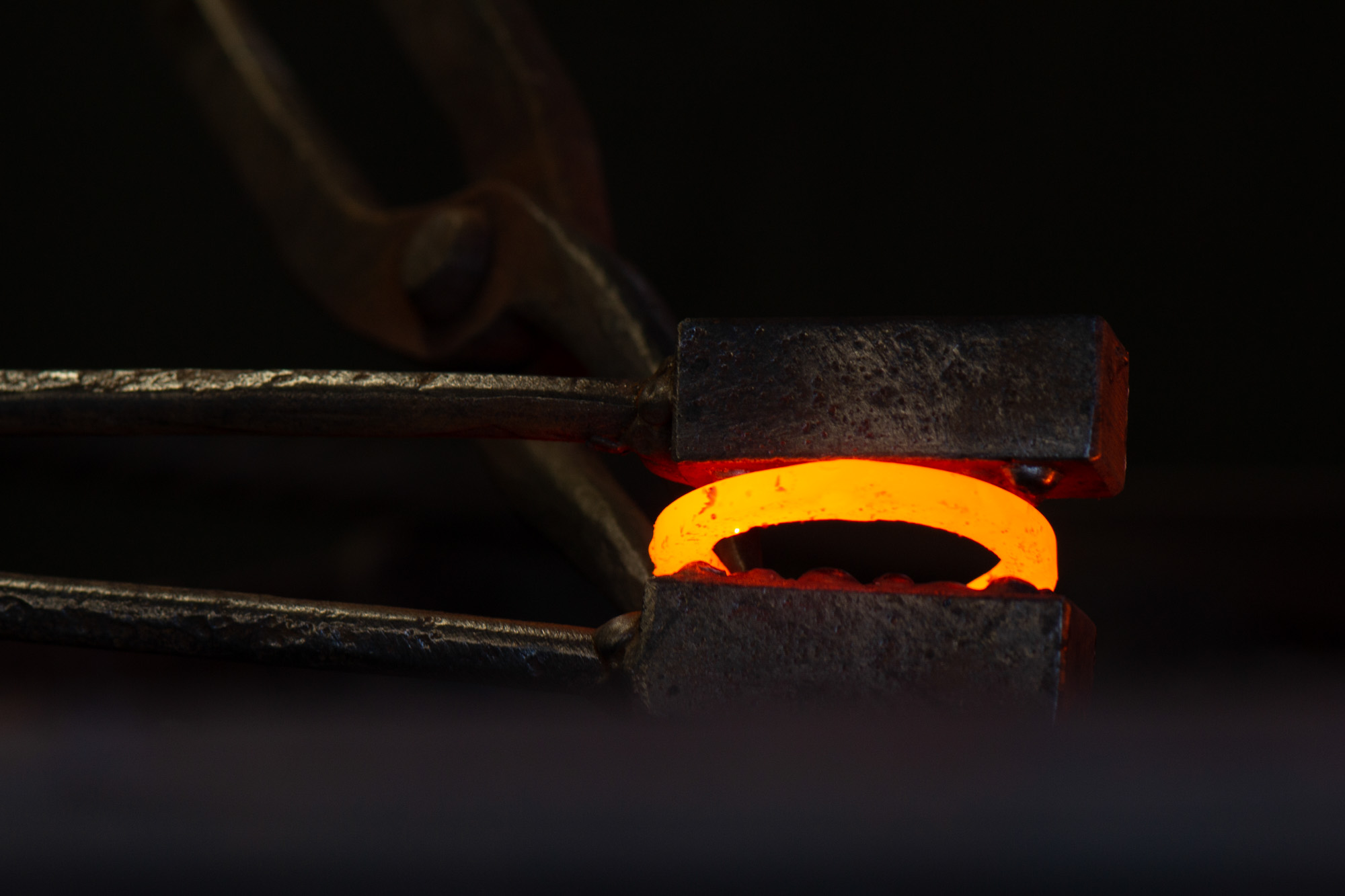 Placed into the forge until they are red hot. At approximately 1200 degrees, they are removed from the heat of the fire and struck using bespoke texture tools.