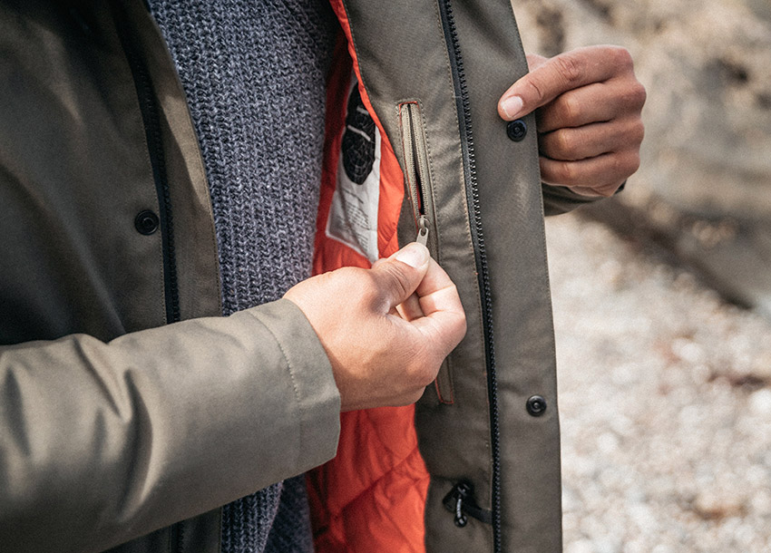 Fully waterproof and sustainable parka jacket for men from Finisterre features internal zipped pockets for valuables
