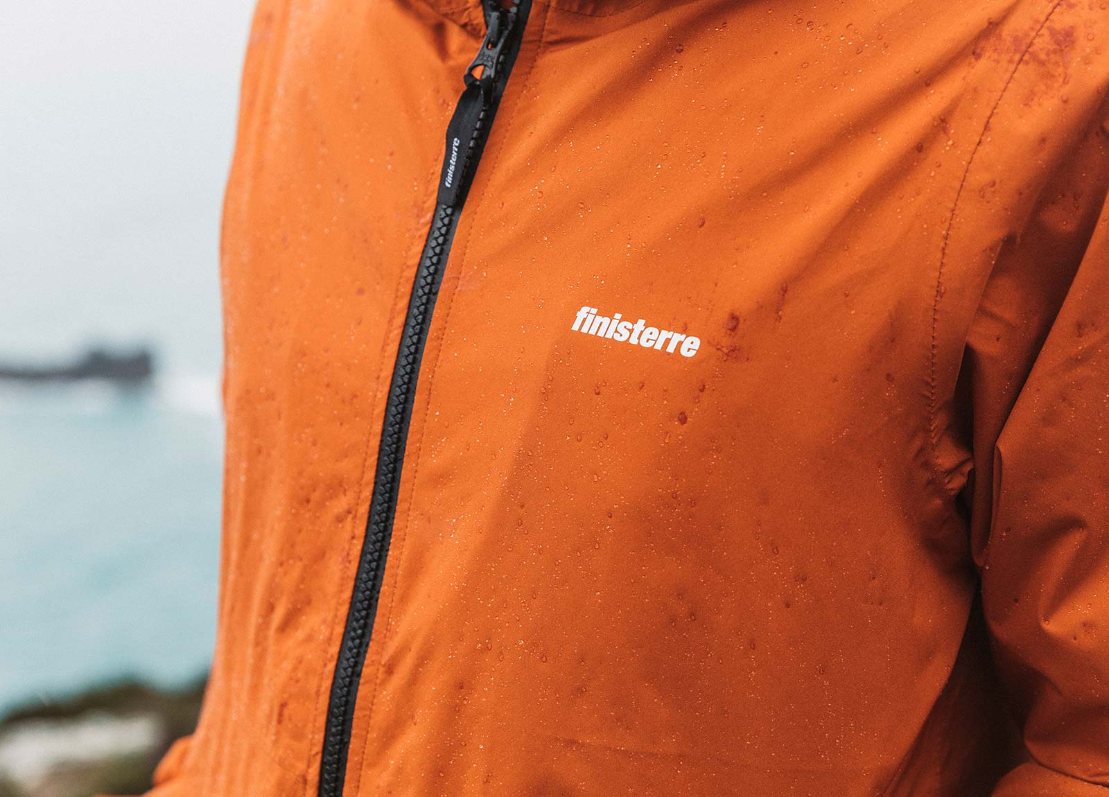Fully waterproof aquaguard zip keeps water out from the Rainbird waterproof jacket.